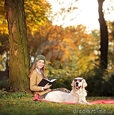 Smiling young woman relaxing with her dog