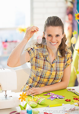 Free Smiling Young Woman Showing Easter Decorative Egg Stock Image - 39799231