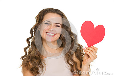 Smiling young woman showing valentines day cards
