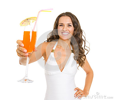 Smiling young woman in swimsuit giving cocktail