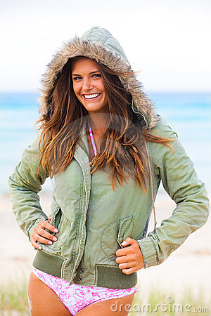 Smiling Young Woman in Swimsuit and Hooded Coat