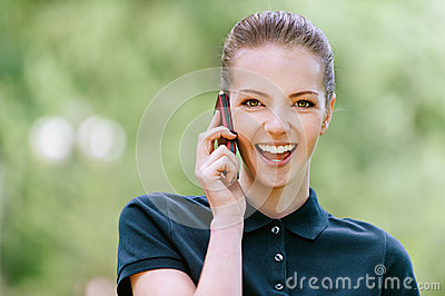 Smiling young woman talking on