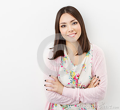 Smiling Young woman teenager arms crossed, in pink