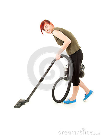 Smiling young woman with a vacuum cleaner