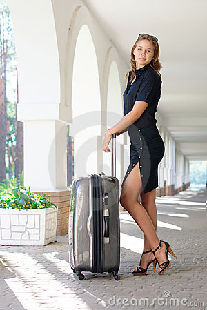 Smiling young women with luggage