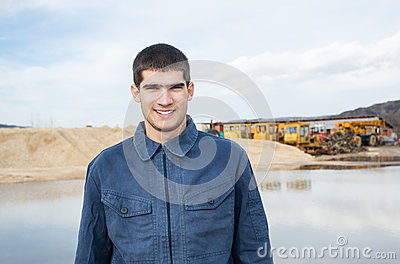 Smiling young worker at construction site