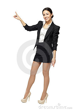 Smilingbusiness woman pointing at copy space