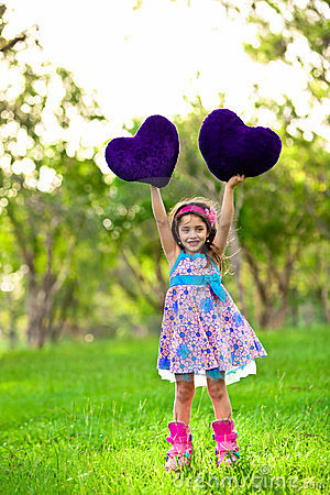 Smilinglittle girl with a heart