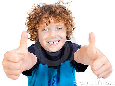Smilling cute little boy gesturing thumbs up