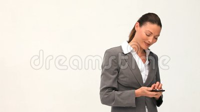 Smilling and pretty businesswoman phoning Stock Photo