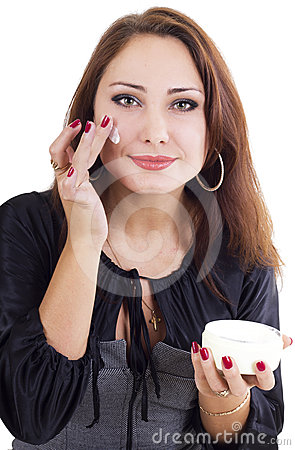Smilling woman with face cream