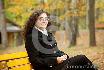 Smilling woman sitting on bench