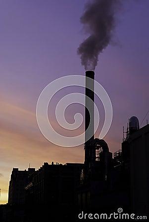 Smoke stacks at sunrise