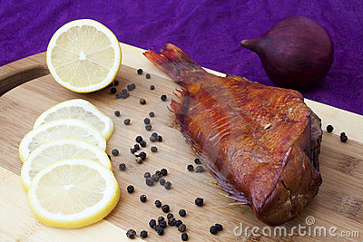Smoked fish on the kitchen board