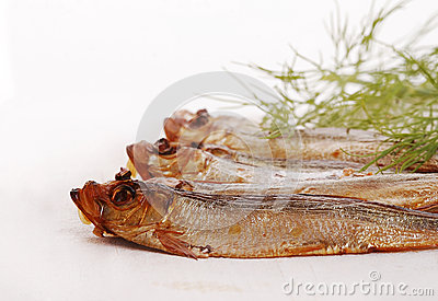Smoked fishes with herbs