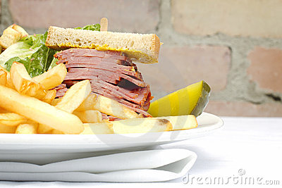 Smoked meat sandwich with frys and ceasar