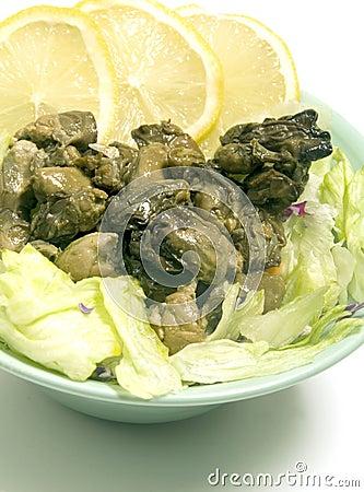 Smoked oyster salad  lemon slices lettuce