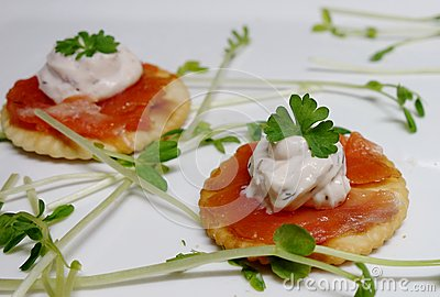 Smoked Salmon Canapes On White Background.