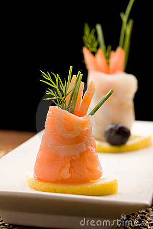 Free Smoked Salmon Rolls With Tomatoes Royalty Free Stock Images - 18517119