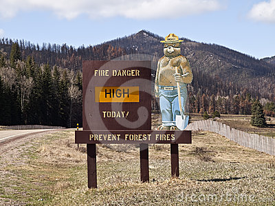 Smokey Bear Sign with Burned Mountain Backdrop Editorial Photo