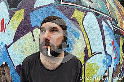 Smoking homeless man