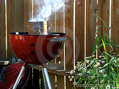 Smoking Red Grill with Flowers