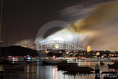 Smoke over Sydney harbor bridge at night