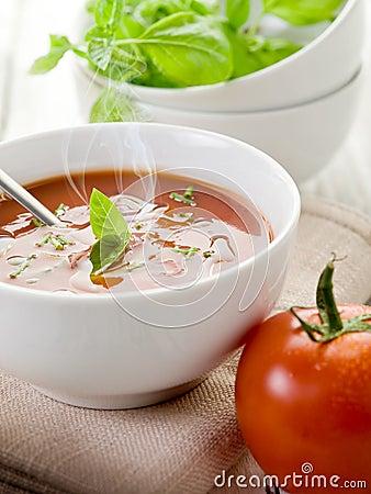 Smoking tomato soup with basil