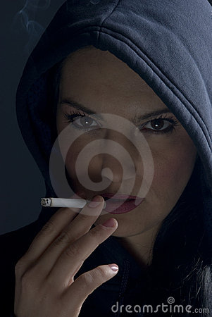 Smoking woman with hood in night