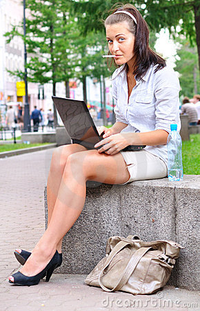 Smoking woman with laptop
