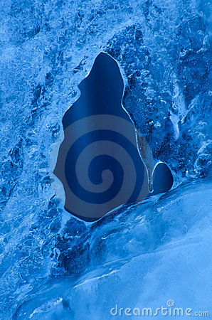 Smooth blue wall of ice with a window