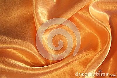 Smooth elegant golden silk as background