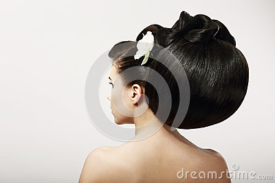 Smooth Healthy Black Hair with Flower. Spa Salon