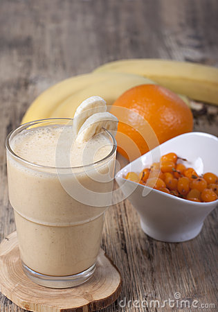 Free Smoothie Of Banana, Orange Juice , Frozen Sea-buckthorn   With Y Royalty Free Stock Photos - 55719798