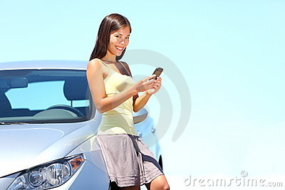 SMS Mobile phone woman by car