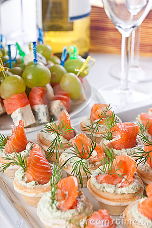 Snacks with salmon and cheese for wine