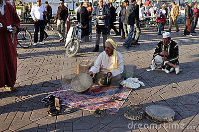 Snake charmer in Marrakesh Editorial Stock Image
