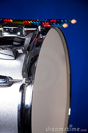 Snare Drum and Sticks Isolated on Blue