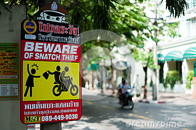 Snatch Thief warning sign Editorial Stock Image