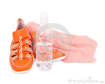 Sneakers, a towel and a bottle of water