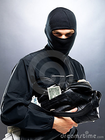 Sneaky thief holding a bag full of money