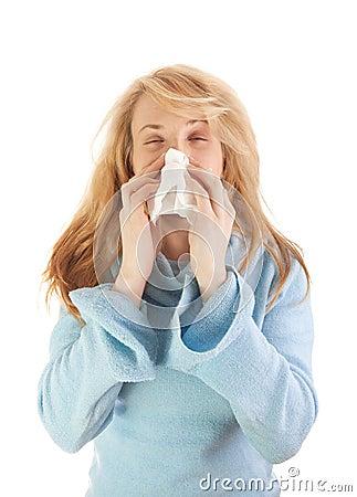 Sneezing girl in blue sweater