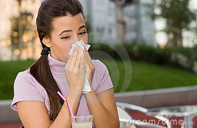 Sneezing teenage girl
