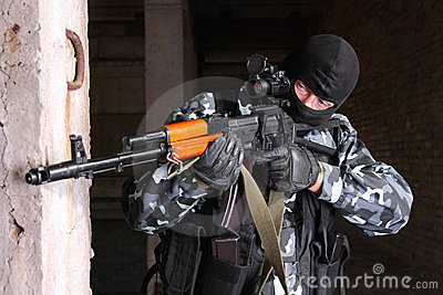 Sniper in black mask targeting