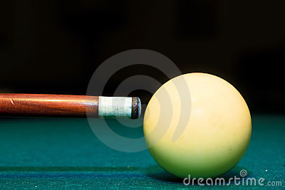 Snooker club and white ball in a billiard table
