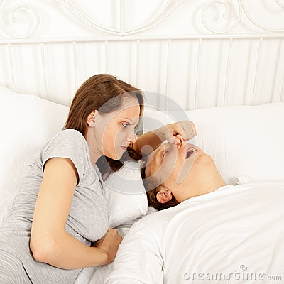 Snoring man in bed