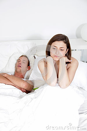 Snoring man, distraught woman