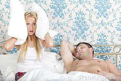 Snoring man and frustrated woman