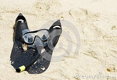 Snorkel equipment on a tropical sandy beach