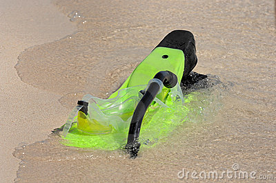 Snorkel and flippers on beach